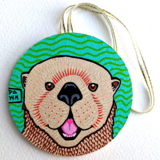 sea otter ornament with ribbon