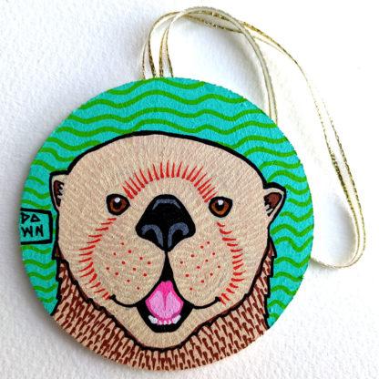 sea otter ornament with ribbon