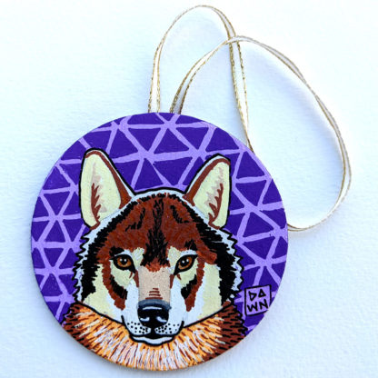 wolf ornament with ribbon